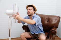 Flushed man feeling hot Stock Photo