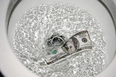 Flushing money Royalty Free Stock Photos