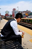 Flushing, NY: Asian Youth Listening to ipod Royalty Free Stock Photography