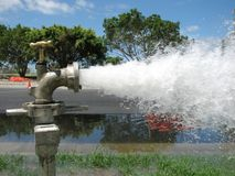 Flusing Water Pipes. Water being flushed out from underground pipes royalty free stock photos