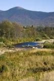 Flussi e montagne del NH Immagini Stock