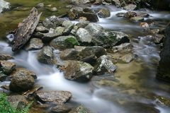 Flussi e pietre fotografia stock