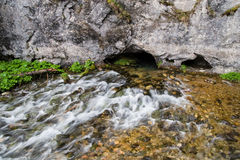 Flusso dalla caverna Immagini Stock Libere da Diritti