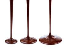 Flusso del cioccolato caldo isolato fotografia stock libera da diritti