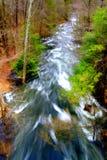 flusso scorrente veloce nella primavera Fotografia Stock