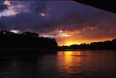 Flusssonnenuntergang Stockfotografie