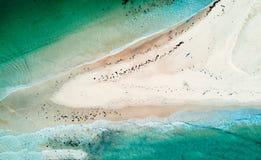 Flut über dem Sandspucken Stockbild