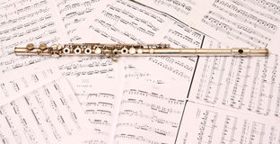 Flute. A used flute rests across an open musical score Stock Image