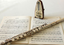 Flute. Shett of music with flute and metronome Royalty Free Stock Image