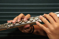 Flute. Detail of the hands of a musician playing the flute Stock Images