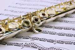 Flute. Macro of flute detail on sheet music Stock Photo