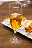 Flute with aperitif and pretzels closely Stock Images