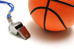 Flute and basketball. Coach flute and a basketball royalty free stock photos