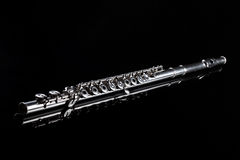 Flute on black background. Music instrument Stock Photos
