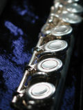 Flute on blue. Details of a flute on its blue velvet internal box Royalty Free Stock Image