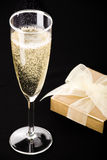 Flute of champagne on black Royalty Free Stock Photos