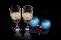 Flute and christmas balls on black Stock Photography