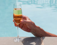 Flute of cold champagne in hand Royalty Free Stock Images
