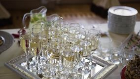 Flute of cold white champagne or sparkling wine standing on the tray at a festive event or celebration stock video