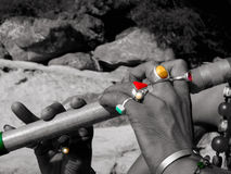 Flute and coloured rings. Man playing the flute in India on the side of the holy ganges Royalty Free Stock Images
