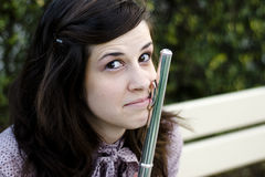 Flute and funny expression. Young attractive woman holding her flute with a funny expression Royalty Free Stock Photos