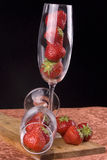 Flute glass with strawberries. Two flute glasses filled with ripe strawberries Stock Photo