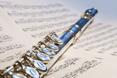 Flute instrument on the notes. Flute instrument on the note symphony background Royalty Free Stock Image