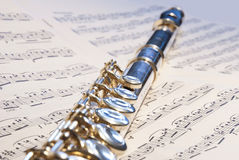 Flute instrument on the notes Stock Images