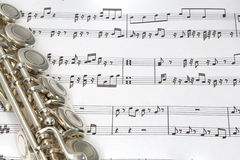 Flute keys on Sheet music Stock Photography