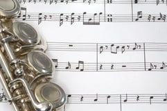 Flute keys on Sheet music. Macro shot of Flute on sheet music Stock Photo