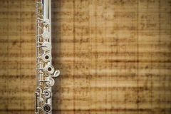 Flute Middle Joint. /Solid Silver Sterling/ On Music Score Background Stock Photo