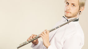 Flute music playing flutist musician performer Stock Photo