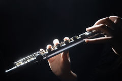 Flute musical hands. Flute music instrument details playing. Hand of flutist musician on black Stock Photo
