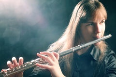 Flute musician flutist. Flute playing flutist musician performer with bright musical instrument Royalty Free Stock Photography