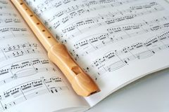Flute and notes. Wooden flute on notesheet stock images