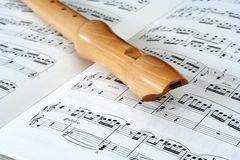 Flute & notes. Wooden flute on notesheet Royalty Free Stock Image
