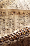 Flute on old handwritten sheet music bottom top vertical view Stock Images