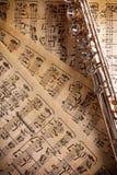 Flute on old handwritten sheet music top view vertical compositi Stock Photos