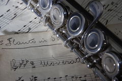 Flute and old Sheet music Royalty Free Stock Image