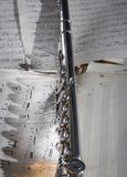 Flute and old Sheet music. Western concert flute with a old sheet music Royalty Free Stock Image