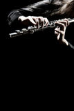 Flute orchestra instrument playing. Flute orchestra instruments playing flutist musician with musical instrument on black Stock Photography