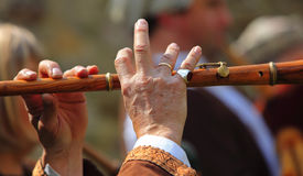 Flute performance abstract. Detail of hands of a flute player during a medieval music performance Stock Photo