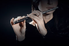 Flute piccolo with hands closeup Stock Images