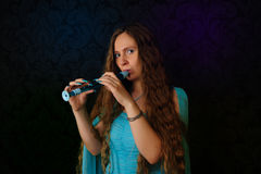 Flute player Stock Images