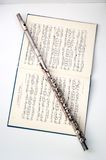 A flute on sheet music Stock Photo