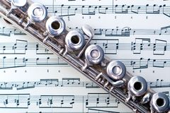 A flute on sheet music Royalty Free Stock Photo