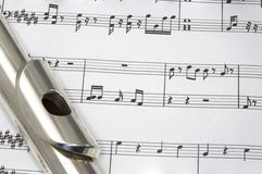 Flute on Sheet music Royalty Free Stock Photo