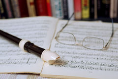 Flute soprano. Soprano flute and glasses lying on the note record Stock Images