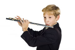 Flute sounds. The 11-year-old boy plays a flute Royalty Free Stock Image