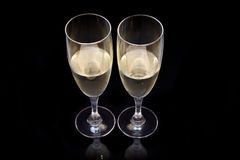 Flute with sparkling wine on black Royalty Free Stock Images